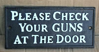 """Grade """"A""""  <> PLEASE CHECK YOUR GUNS AT THE DOOR <> Old West Iron Sign"""