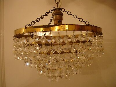 A vintage 4 tier crystal and brass chandelier max diameter 9.5 inches