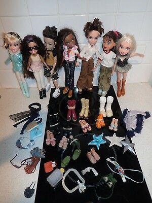 Seven Bratz dolls - five girls two boys plus shoes and some accessories.