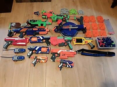 15 Nerf guns job lot plus bullets, vest, belt and targets and walkie talkies