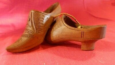 Vintage pair of hand made Dutch wooden shoes. Signed V. Philips 1895.