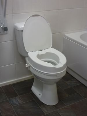 """Drive DeVilbiss 4"""" Raised Toilet Seat with Lid"""