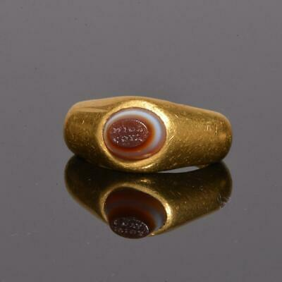 An exhibited Roman Gold and inscribed Eye Agate Finger Ring, ca. 2nd century AD