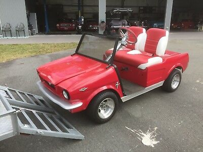 ford mustang shaped electric buggy with custom trailer
