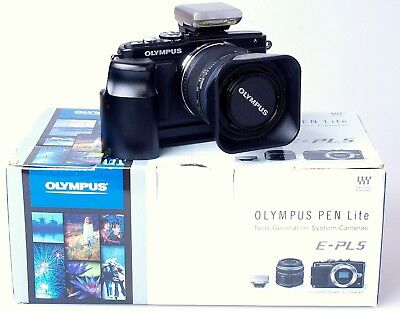 Olympus E-PL5 with 14-42mm lens flash and grip. Boxed