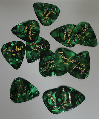Fender  medium guitar  Picks GREEN MOTO  12 picks