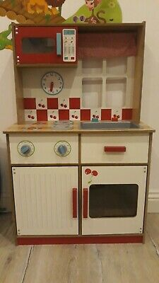 Childrens wooden play kitchen and some accessories
