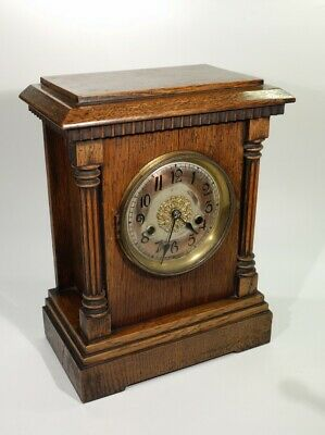 Antique Oak Mantel Clock Complete with Pendulum And Winding Key.