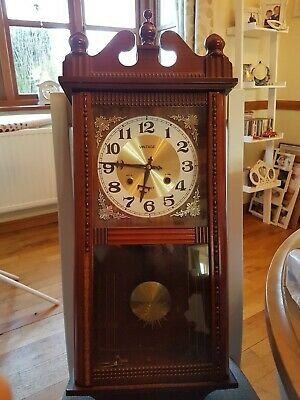Vintage wall Clock With Key. Wooden case. Not Workingmechanical movement chimes