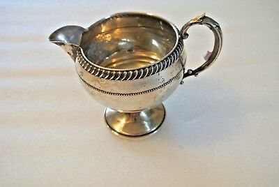 Fisher Silversmiths, a Sterling cream pitcher --weights--95 grams