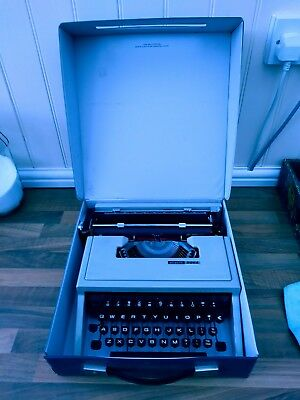 OLIVETTI DORA Type writer. Good condition with case.