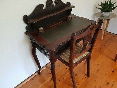 antique desk with original ink pots and matching chair with original fabric