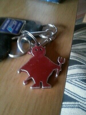 Manchester United?  Red devil metal keyring.
