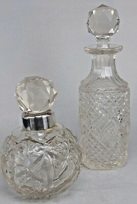 Two scent bottles Edwardian cut glass perfume bottles one silver collar 1910