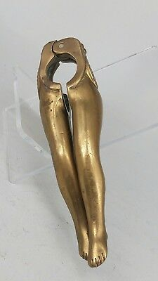 Pair of erotic brass nutcrackers in the form of shapely legs