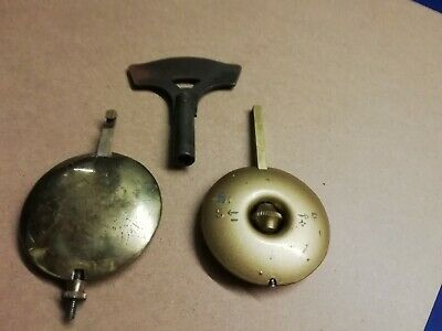 2 Vintage. Mantle Clock pendulums/bobs. And a key. Spares.