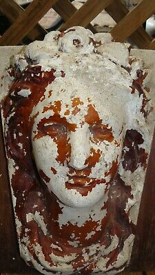 Old statue,wall mounted head,very old.