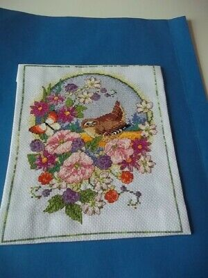 completed cross stitch of a wren amongst flowers