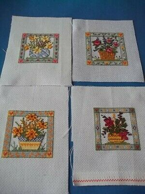 completed cross stitch set of four floral card toppers