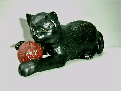 Bretby model of a black cat with inset green eyes and short ears with red ball