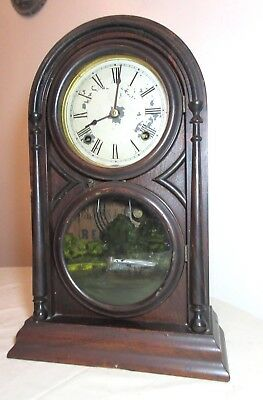 antique 1800's Atkins 8 day wooden dual window reverse painted mantel clock