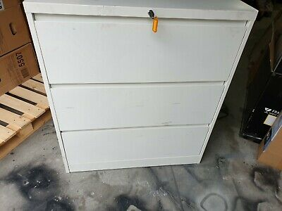 3 Drawer Lateral Filing Cabinet White New with key has minor Dent and scratches