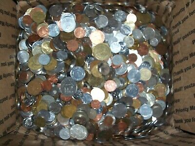 At least 25 foreign world coins. 1/4 pound lbs of foreign world coins.