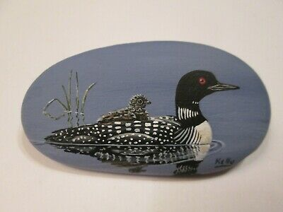 Loon and Chick hand painted on a rock by Ann Kelly