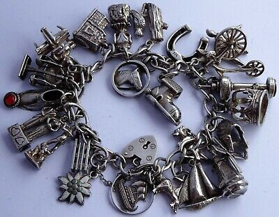Gorgeous vintage solid silver charm bracelet & 24 silver charms, rare,open, move