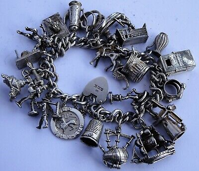 Wonderful vintage solid silver charm bracelet & 21 charms. Rare, open, move