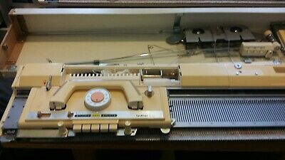 Brother knitting machine with lace carriage