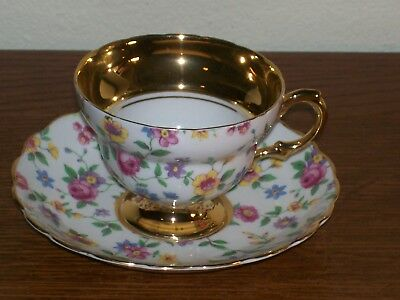 Rosina Cup & Saucer in Pretty Floral / Chintz Pattern Footed with Lots of GOLD