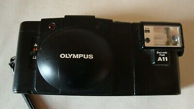 Vintage Olympus xa2 camera with A11 electronic flash.