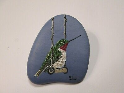 Hummingbird hand painted on a rock Ann Kelly