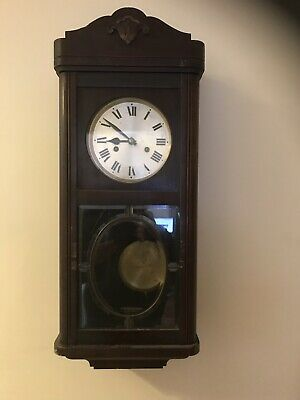 antique pendulum wall clock
