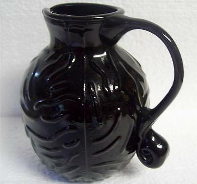 Black ART Glass SEAMED CREAMER PITCHER Applied Handle FLORAL BAS RELIEF 4.25""