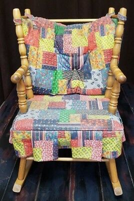 Vintage N.D. Cass Childs wood rocking chair  multi-color cloth seat cushions