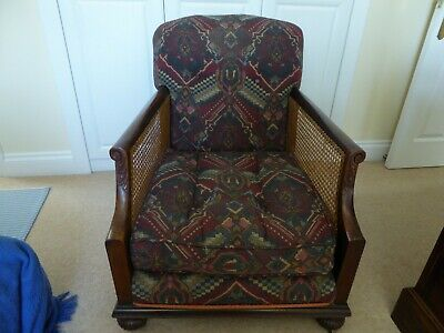 Antique Edwardian caned bergere armchair. Carved wood frame, upholstered seat.