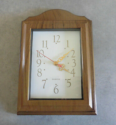 Wall clock with key box.