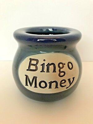 Blue ceramic jar says Bingo Money the perfect place to drop your change each day