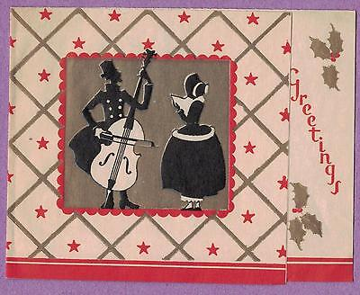 817Rt VTG CHRISTMAS GREETING CARD SILHOUETTE COUPLE WOMAN SINGS MAN PLAYS CELLO