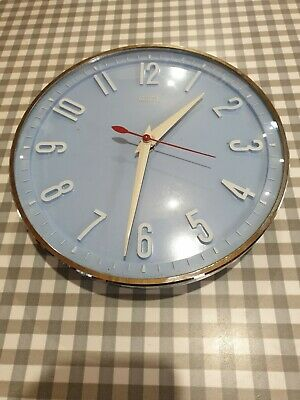 Vintage retro Metamec electric kitchen wall clock. Baby blue 21cm Diameter