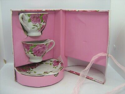 Pair tea cups and saucers in presentation case, rose patterned