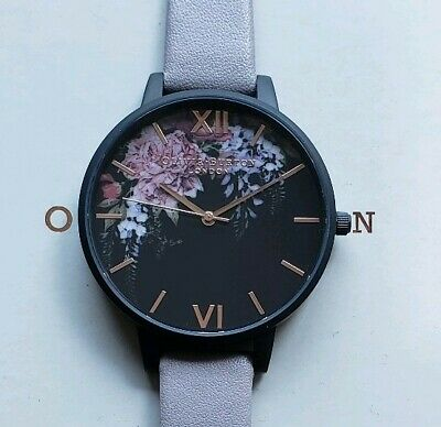 OLIVIA BURTON WATCH WITH 38mm BLACK FACE WITH MULTICOLOR FLORAL PATTERN.