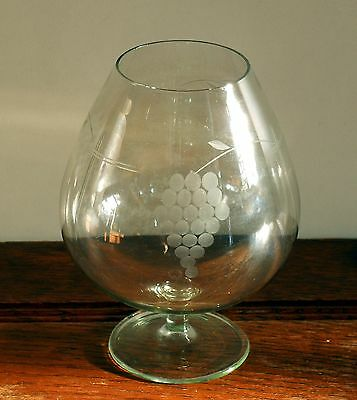 A fine blown balloon brandy / tasting glass with etched bunches grapes