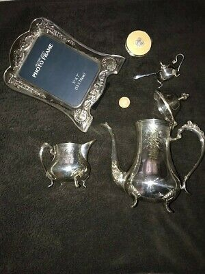 Silver plated items ,Teapot ,cream jug,mustard pot and others