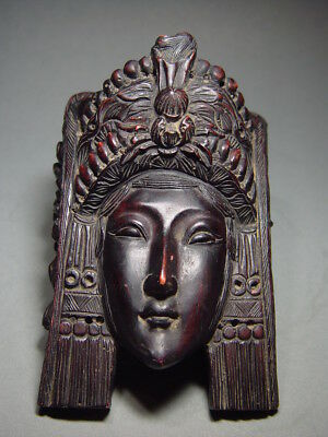 AN EXOTIC INDONESIAN GODDESS WALL MASK RELIEF ELEMENT. 19/20th C.