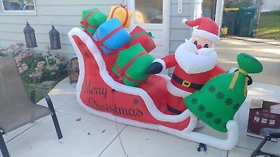 7ft. Wide Airblown Inflatable Santa w/ Presents in Sleigh Outdoor Decor