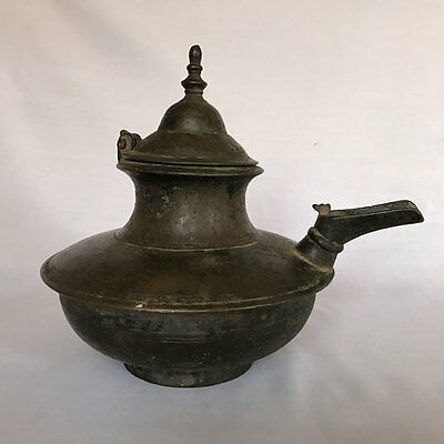 An old or antique solid brass hindu ritual spouted lota vessel or pot