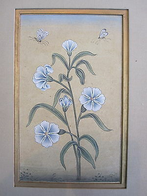 An old or antique look miniature paper painting of mughal style flowers